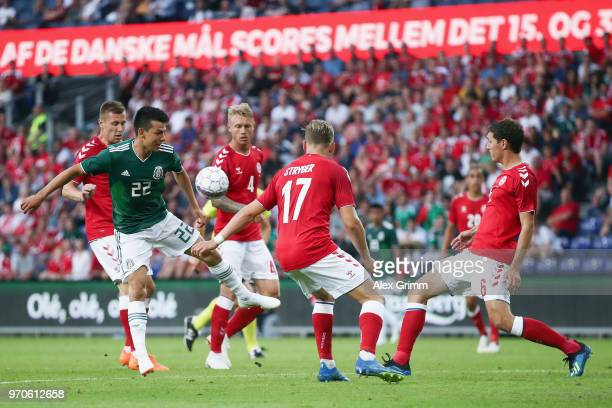 Hirving Lozano of Mexico is challenged by Jens Stryger Larsen Andreas Christensen and Simon Kjaer during the international friendly match between...