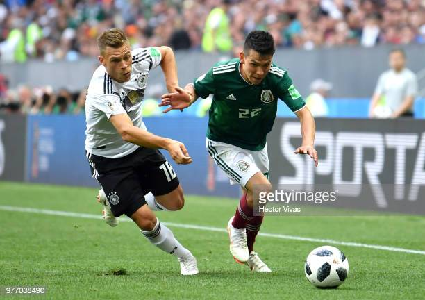 Hirving Lozano of Mexico is challenged by Joshua Kimmich of Germany during the 2018 FIFA World Cup Russia group F match between Germany and Mexico at...