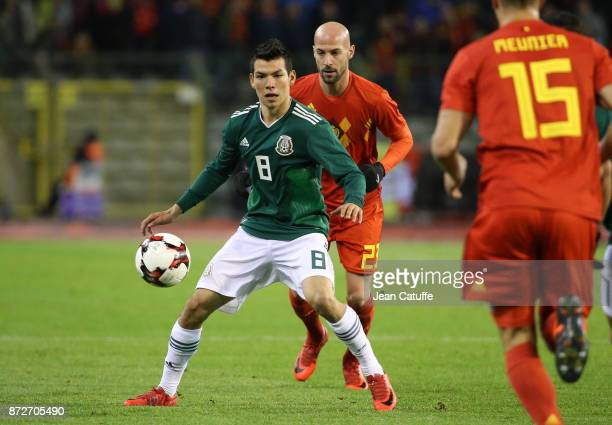 Hirving Lozano of Mexico Laurent Ciman of Belgium during the international friendly match between Belgium and Mexico at King Baudouin Stadium on...