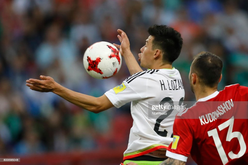 Hirving Lozano (L) of Mexico national team and Fedor Kudriashov of Russia national team vie for the ball during the Group A - FIFA Confederations Cup Russia 2017 match between Russia and Mexico at Kazan Arena on June 24, 2017 in Kazan, Russia.