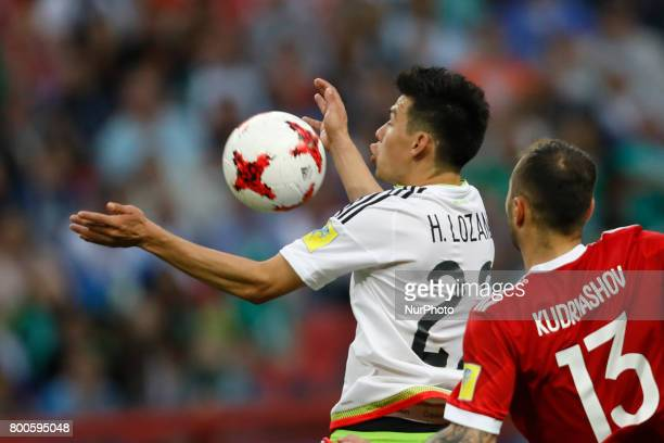Hirving Lozano of Mexico national team and Fedor Kudriashov of Russia national team vie for the ball during the Group A FIFA Confederations Cup...