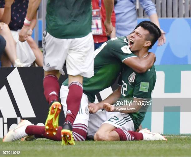 Hirving Lozano of Mexico reacts after scoring the opener against Germany during the first half of a World Cup group stage match at Luzhniki Stadium...
