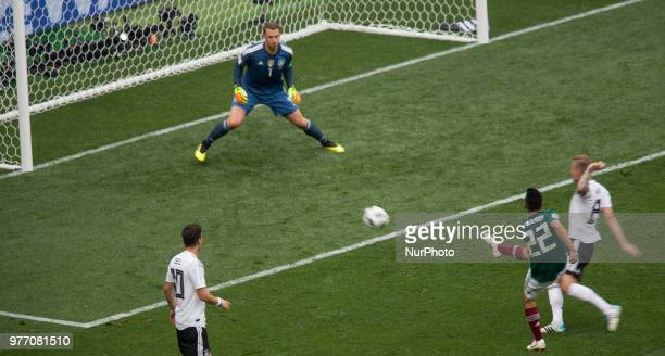 Hirving Lozano of Mexico right shoots to score a goal against goalkeeper Manuel Neuer of Germany in their Group F match during the 2018 FIFA World...