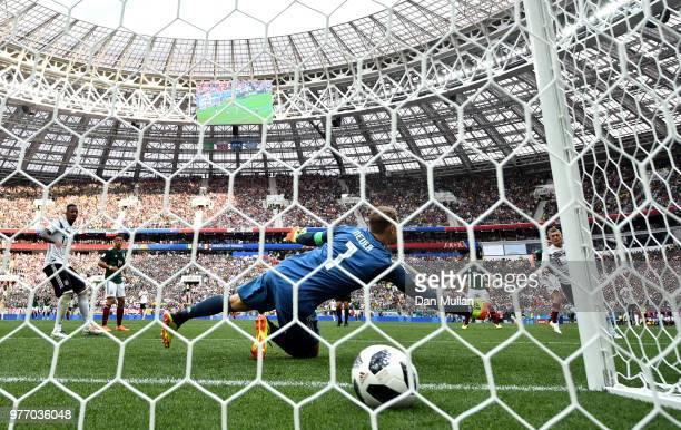 Hirving Lozano of Mexico scores his team's first goal past Manuel Neuer of Germany during the 2018 FIFA World Cup Russia group F match between...