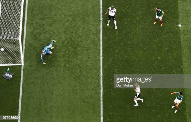 Hirving Lozano of Mexico scores his team's first goal under pressure from Toni Kroos of Germany during the 2018 FIFA World Cup Russia group F match...