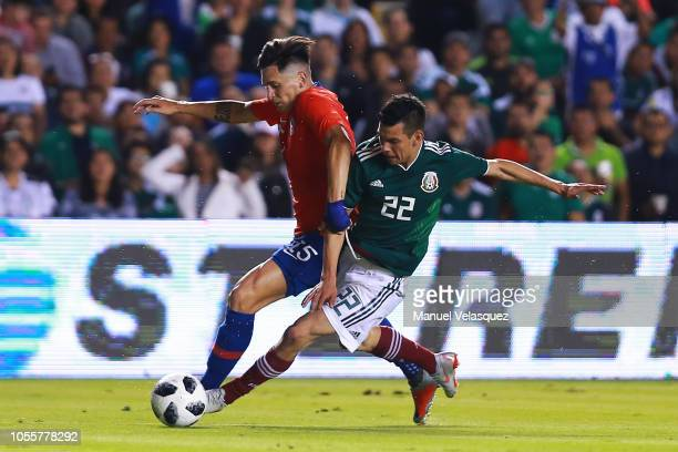 Hirving Lozano of Mexico struggles for the ball against Alfonso Parot of Chile during the international friendly match between Mexico and Chile at La...