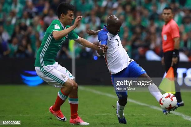 Hirving Lozano of Mexico struggles for the ball with Damarcus Beasly of United States during the match between Mexico and The United States as part...