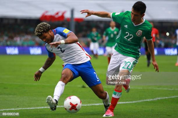 Hirving Lozano of Mexico struggles for the ball with DeAndre Yeldin of US during the match between Mexico and The United States as part of the FIFA...