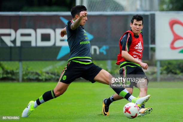 Hirving Lozano of Mexico struggles for the ball with teammate Edson Alvarez during a Mexico's National Team training session ahead of the Qualifier...