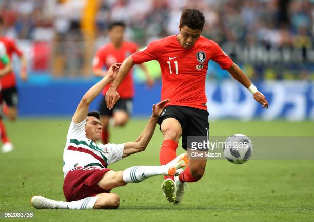 Hirving Lozano of Mexico tackles Hwang Heechan of Korea Republic during the 2018 FIFA World Cup Russia group F match between Korea Republic and...