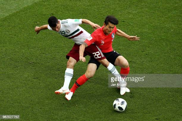 Hirving Lozano of Mexico tackles Yong Lee of Korea Republic during the 2018 FIFA World Cup Russia group F match between Korea Republic and Mexico at...