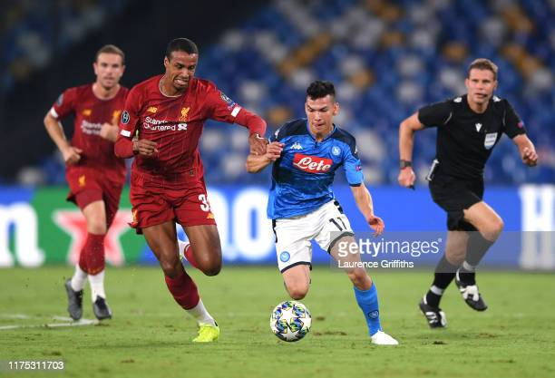 Hirving Lozano of Napoli takes on Joel Matip of Liverpool during the UEFA Champions League group E match between SSC Napoli and Liverpool FC at...
