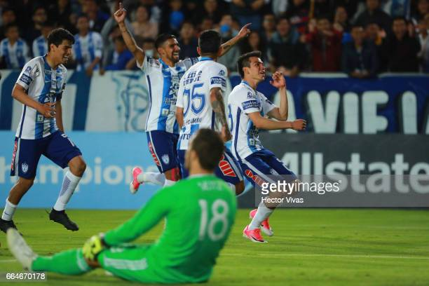 Hirving Lozano of Pachuca celebrates with teammates after scoring the third goal of his team during the semifinals second leg match between Pachuca...