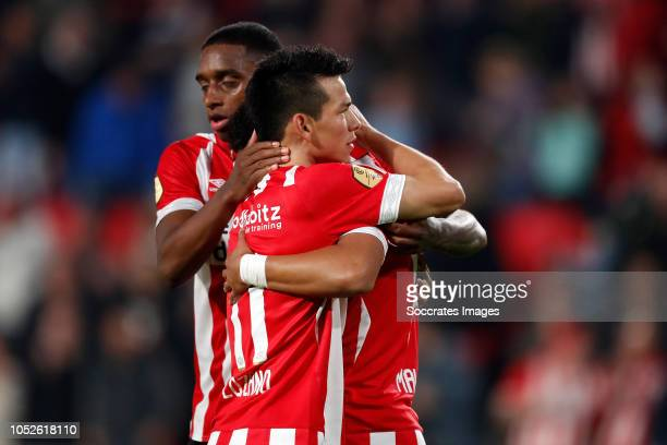 Hirving Lozano of PSV celebrates 60 with Pablo Rosario of PSV Donyell Malen of PSV during the Dutch Eredivisie match between PSV v FC Emmen at the...