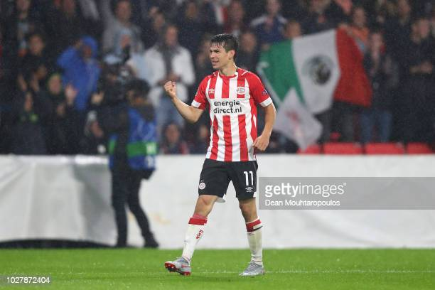Hirving Lozano of PSV celebrates scoring the third goal during the UEFA Champions League Playoff second leg match between PSV Eindhoven and BATE...