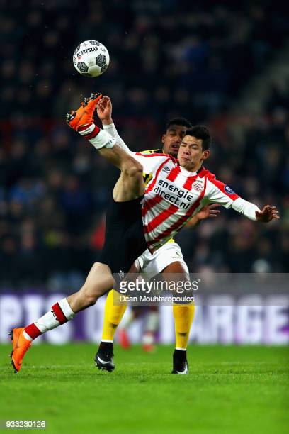Hirving Lozano of PSV competes for the ball with Jerold Promes of VVV Venlo during the Dutch Eredivisie match between PSV Eindhoven and VVV Venlo...