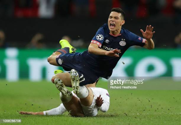 Hirving Lozano of PSV Eindhoven is tackled by HeungMin Son of Tottenham Hotspur during the Group B match of the UEFA Champions League between...