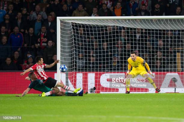 Hirving Lozano of PSV Eindhoven scores the opening goal under pressure from Toby Alderweireld of Tottenham Hotspur during the Group B match of the...
