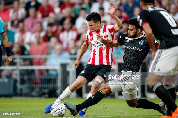 Hirving Lozano of PSV, Eray Ervin Comert of FC Basel during the UEFA Champions League match between PSV v Fc Basel at the Philips Stadium on July 23,...