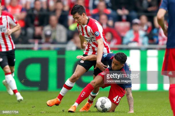 Hirving Lozano of PSV Justin Kluivert of Ajax during the Dutch Eredivisie match between PSV v Ajax at the Philips Stadium on April 15 2018 in...