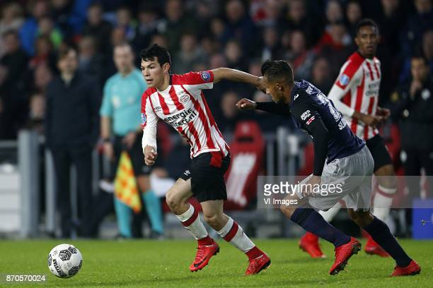 Hirving Lozano of PSV Luciano Slagveer of FC Twente during the Dutch Eredivisie match between PSV Eindhoven and FC Twente Enschede at the Phillips...