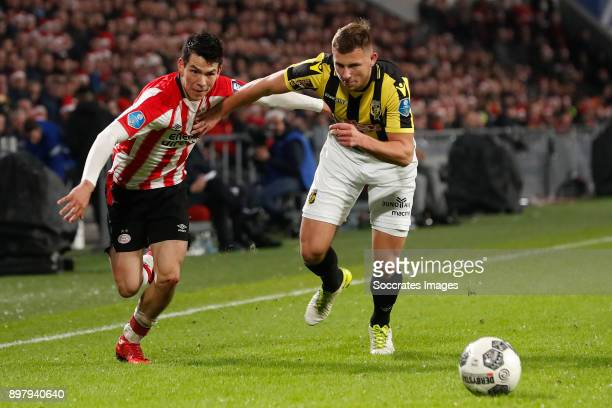 Hirving Lozano of PSV Thomas Oude Kotte of Vitesse during the Dutch Eredivisie match between PSV v Vitesse at the Philips Stadium on December 23 2017...
