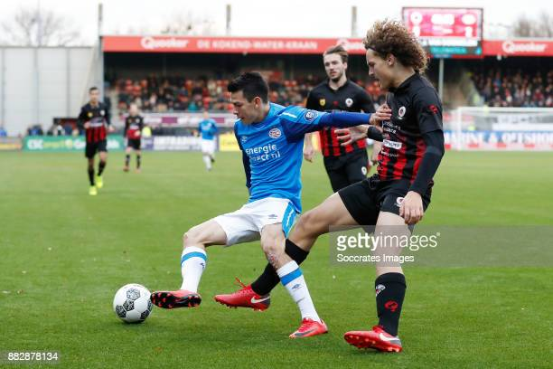 Hirving Lozano of PSV Wout Faes of Excelsior during the Dutch Eredivisie match between Excelsior v PSV at the Van Donge De Roo Stadium on November 26...