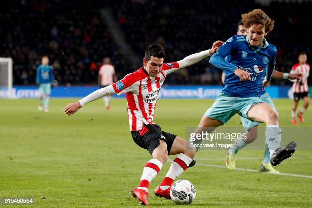 Hirving Lozano of PSV Wout Faes of Excelsior during the Dutch Eredivisie match between PSV v Excelsior at the Philips Stadium on February 7 2018 in...