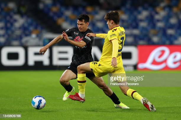 Hirving Lozano of SSC Napoli battles for possession with Aaron Hickey of Bologna during the Serie A match between SSC Napoli and Bologna FC at Stadio...