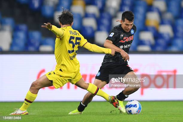 Hirving Lozano of SSC Napoli battles for possession with Emanuel Vignato of Bologna during the Serie A match between SSC Napoli and Bologna FC at...
