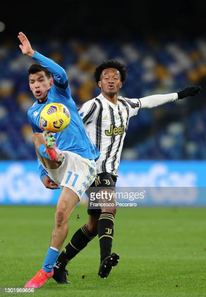 Hirving Lozano of S.S.C. Napoli battles for possession with Juan Cuadrado of Juventus during the Serie A match between SSC Napoli and Juventus at...