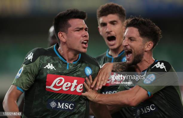 Hirving Lozano of SSC Napoli celebrates his goal with his teammate Dries Mertens during the Serie A match between Hellas Verona and SSC Napoli at...