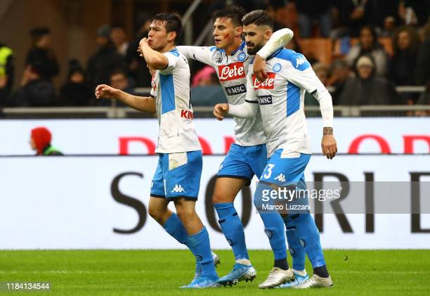 Hirving Lozano of SSC Napoli celebrates with his teammates after scoring the opening goal during the Serie A match between AC Milan and SSC Napoli at...
