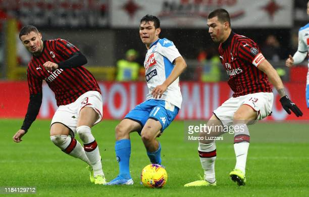 Hirving Lozano of SSC Napoli competes for the ball with Rade Krunic and Alessio Romagnoli of AC Milan during the Serie A match between AC Milan and...