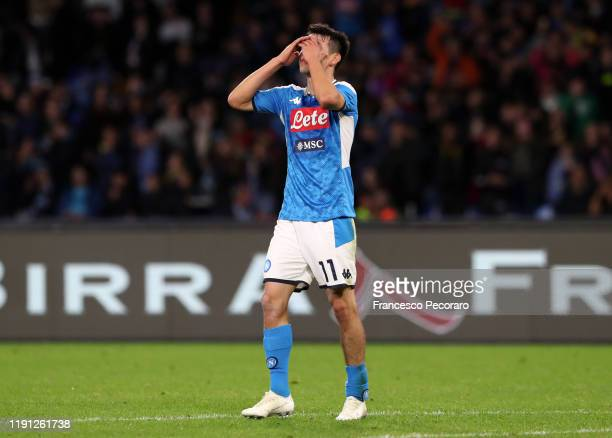 Hirving Lozano of SSC Napoli stands disappointed during the Serie A match between SSC Napoli and Bologna FC at Stadio San Paolo on December 01 2019...