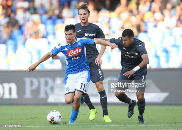 Hirving Lozano of SSC Napoli vies with Jeison Murillo of UC Sampdoria during the Serie A match between SSC Napoli and UC Sampdoria at Stadio San...