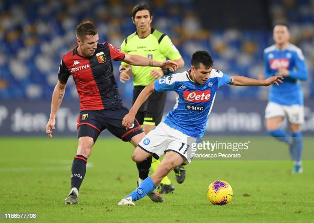 Hirving Lozano of SSC Napoli vies with Lukas Lerager of Genoa CFC during the Serie A match between SSC Napoli and Genoa CFC at Stadio San Paolo on...