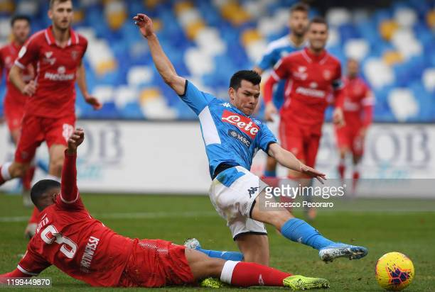 Hirving Lozano of SSC Napoli vies with Mardochee Nzita of Perugia during the Coppa Italia match between SSC Napoli and Perugia on January 14 2020 in...