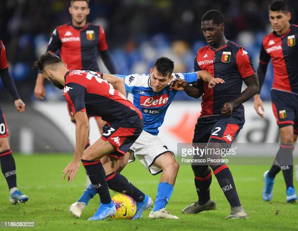 Hirving Lozano of SSC Napoli vies with Marko Pajac and Cristian Zapata of Genoa CFC during the Serie A match between SSC Napoli and Genoa CFC at...