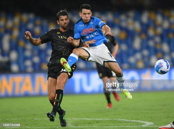 Hirving Lozano of SSC Napoli vies with Pietro Ceccaroni of Venezia FC during the Serie A match between SSC Napoli and Venezia FC at Stadio San Paolo...