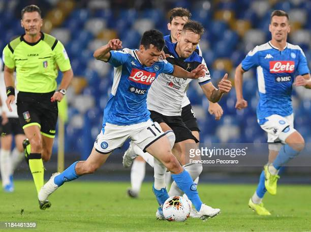 Hirving Lozano of SSC Napoli vies with Robin Gosens of Atalanta BC during the Serie A match between SSC Napoli and Atalanta BC at Stadio San Paolo on...