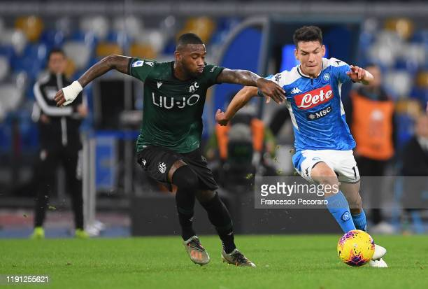Hirving Lozano of SSC Napoli vies with Stefano Denswil of Bologna FC during the Serie A match between SSC Napoli and Bologna FC at Stadio San Paolo...