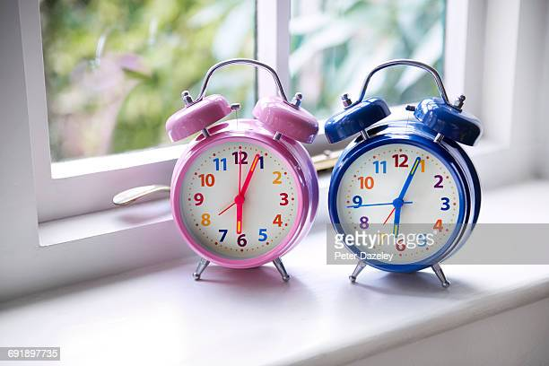 his and hers alarm clocks in bedroom - his and hers stock pictures, royalty-free photos & images