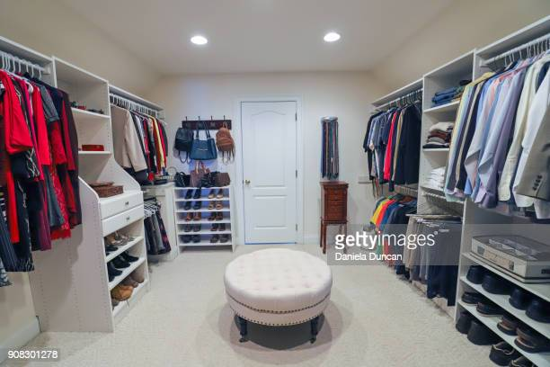 his and hers closet - walk in closet stock photos and pictures