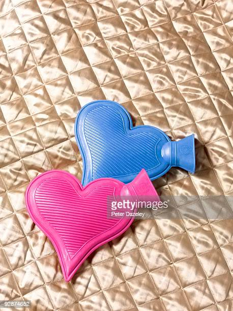 His and Hers heart-shaped hot water bottles