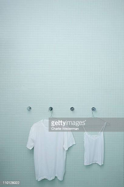his and hers shirts drying in shower. - his and hers stock pictures, royalty-free photos & images