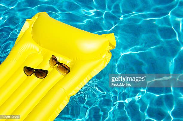 His and Hers Sunglasses Float on Yellow Pool Raft
