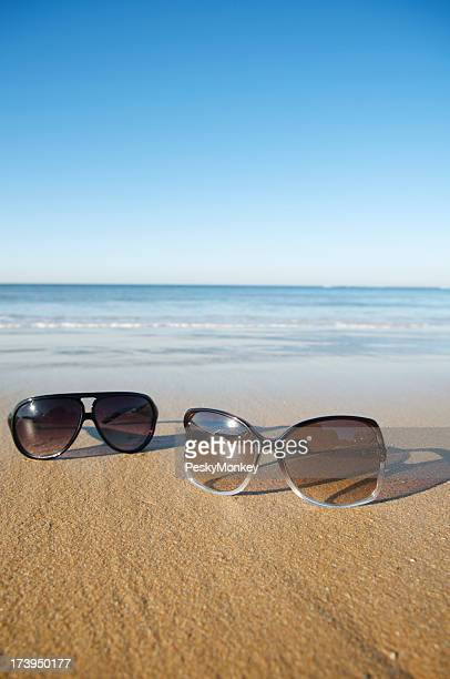 His and Hers Sunglasses on the Beach