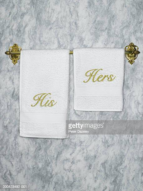 His and hers towels on towel rail