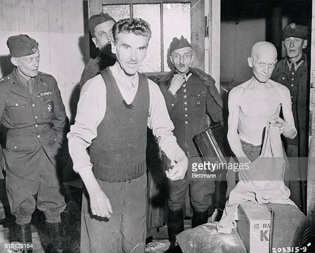 His bones stripped of every ounce of flesh this man who has spent the last five years in a Nazi prison camp at Dossel Germany exchanges his...